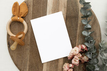 Baby Shower / Blank Card Mockup Flat Lay With Flowers And Wood