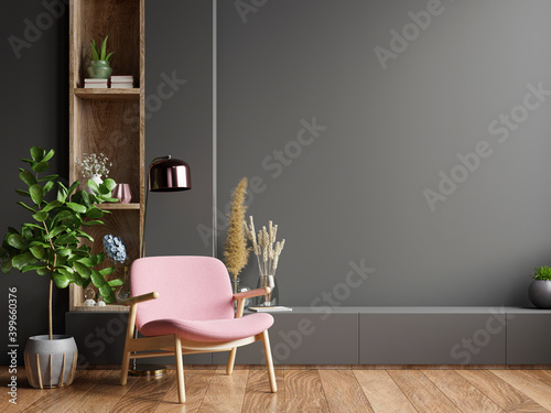 Fototapeta Colorful interior with a pink armchair on empty dark wall background. obraz