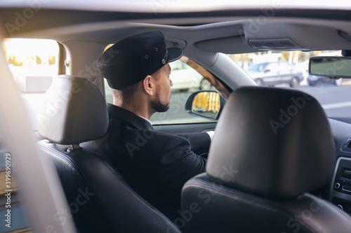 Obraz na plátně Handsome chauffeur driving luxury car