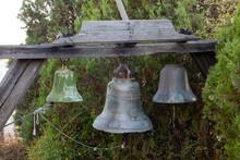 Old Metal Church Bells In Church Yard