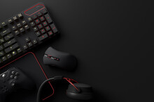 Top View Of Gamer Workspace And Gear Like Mouse, Keyboard, Joystick, Headset, VR