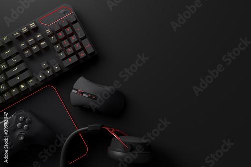 Obraz na plátně Top view of gamer workspace and gear like mouse, keyboard, joystick, headset, VR