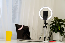 Laptop, Lamp And Tripod On The Table For Online Interview