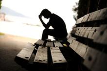 Dramatic Concept, Silhouette Of Sad Depressed Man Sitting