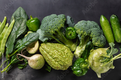 Fotografering Raw healthy food, protein source on dark stone background, top view