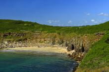 Sandy Beach At Pointe De Kermorvan, On The Horizon Wind Power Plant, Brittany, France