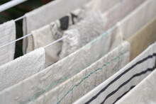 Detail Of Dish Towels And Other White Laundry Hanging On Clothes Horse To Dry
