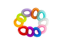 Hair Care Tools Isolated. Close-up Of Multicolored Elastic Spiral Scrunchies Or Hair Bands For Women Hairstyling Isolated On A White Background. Tools From Hairdresser And Beauty Salon.
