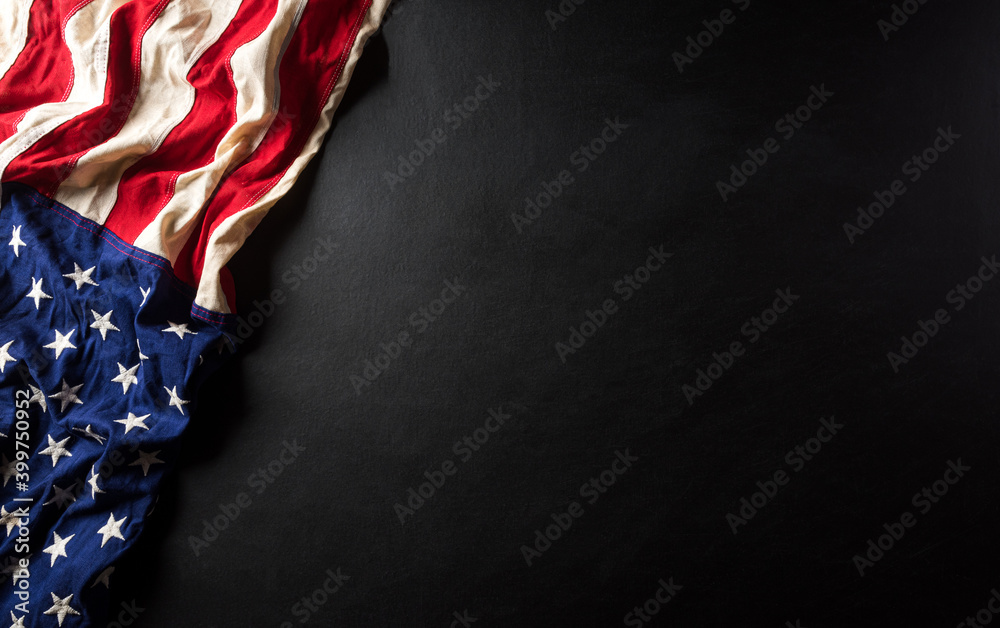 Fototapeta Martin Luther King Day anniversary concept. American flag against black wooden background