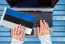 Woman Hands And Flag Of Estonia On Computer, Laptop Keyboard
