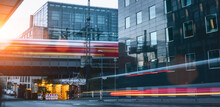 Berlin City Traffic Rush In Office District. Cars And Train Motion Blur Long Exposure Shot