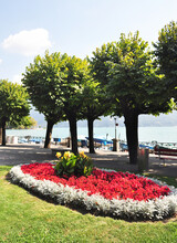 The Lakeside Of Lucerne Has Excellent And Garden Like Landscaping. The Photo Views One Such Area Near A Tourist Boat Area On The Lake.