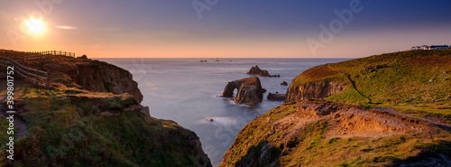 Obraz Sunset over Land's End, Longships and the islands of the Armed Knight and Enys Dodnan, Cornwall, UK - fototapety do salonu
