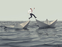 Man Jumps From A Sinking Paper Boat To A Floating One.
