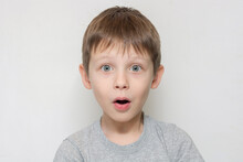 Portrait Of A Very Surprised Boy. Cute Baby Looking At The Camera With Surprised Expression And Open Mouth. Horizontal Photo.