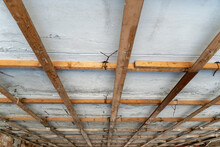 Wooden Base For The New Ceiling. Repair Of The Ceiling In An Old House. Cellular Construction Of Wooden Boards For The Installation Of A Suspended Ceiling