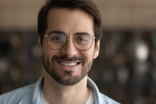 Close Up Portrait Of Smiling Young Caucasian Man In Glasses Look At Camera Show White Healthy Teeth. Happy Millennial Male In Spectacles Recommend Good Quality Eyewear Or Optician Services.