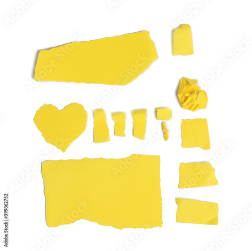 Vászonkép various pieces of torn yellow cardboard isolated on white background