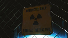 Restricted Area Radioactive Hazard Sign On Wire Fence, Radioactive Material Processing Facility Concept