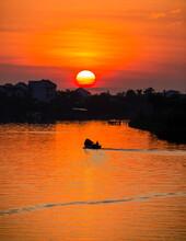 Sunsrise Over The  Thu Bon River  In Hoi An Vietnam