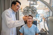 Optometrist Using Phoropter To Check Eyesight Value For Client Eyeglasses