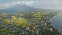Tropic Cityscape At Sea Bay River Banks Aerial. Streets With Cottages And Lodges With Traffic Road. Green Valley At Mayon Volcano Legazpi City, Philippines. Nobody Nature Landscape At Mist Haze