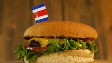 Delicious Burger With Small Costa Rican Flag On Top Of Them With Toothpicks. Yummy Hamburger Rotating.