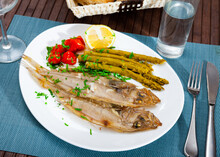 Picture Of Delicious Dish Of Fried Roosterfish With Asparagus, Tomatoes And Lemon
