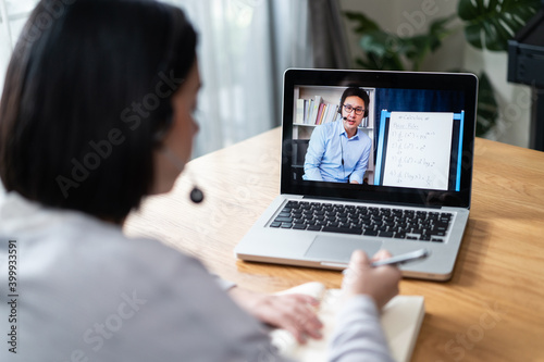 Fotografie, Obraz Homeschool Caucasian girl learning online class by video conference