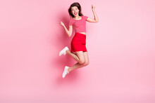 Full Size Photo Of Young Beautiful Cheerful Excited Positive Girl Jump In Victory Isolated On Pink Color Background