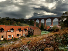 Victorian Railway Viaduct Over The River Esk At Whitby. UK. Sky Added.