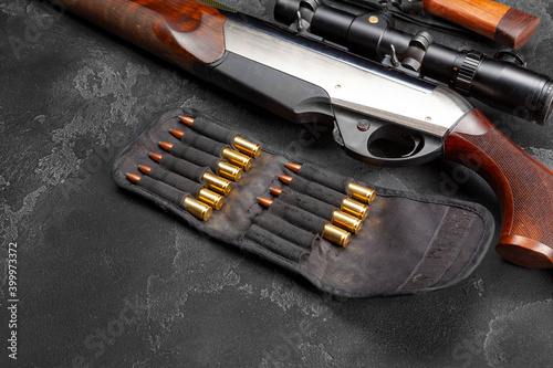 Billede på lærred Close up of hunting shotgun and cartridges on dark grey background