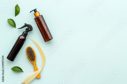 Fotografie, Obraz Top view of female hair care set with comb, shampoo and essential oil