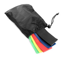 Black Bag With Colorful Elastic Resistance Bands Isolated On White. Fitness Equipment