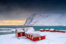 Winter Sunset Over The Arctic Sea And Fishermen Cabins In The Snow, Sorvaer, Soroya Island, Hasvik, Troms Og Finnmark
