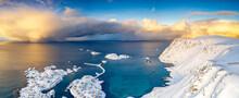 Burning Sky At Sunrise Over The Cold Sea And Sorvaer Village Covered With Snow, Soroya Island, Hasvik, Troms Og Finnmark, Arctic