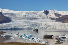 A Glacier Pouring Down Off The Vatnajokull Icecap, The Fjallsjokull Glacier And Fjallsarlon Lagoon, Near Jokulsarlon, Iceland