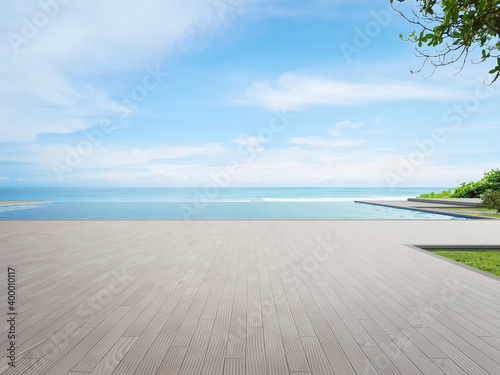 Obraz Luxury beach house with sea view swimming pool and terrace in modern design. Wooden floor deck at vacation home or hotel. 3d illustration of contemporary holiday villa exterior. - fototapety do salonu