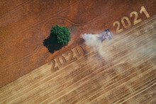 2021 Happy New Year Concept Of Aerial View On The Combine Working On The Large Wheat Field