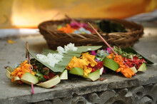 Ritual And Beliefs:  Colorful Flower Basket, Incense, Bananaleaf And Rice As A Hindu Offering On Bali