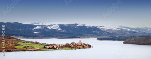Ullibarri Gamboa lake and village in winter in Basque Country