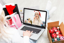 A Happy Family With A Child Is Celebrating Christmas With Their Friends On Video Call Using Webcam. Family Greeting Their Relatives On Christmas Eve Online. New Normal Virtual Event