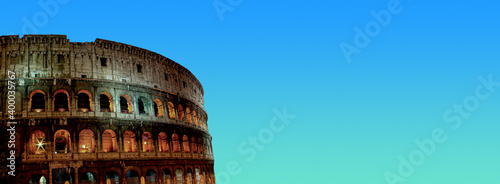 Foto Banner with front view of wonderful ancient Colosseum at night illumination and sunset blue and green sky background with copy space, Rome, Italy