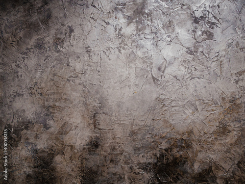 Obraz na plátne background - embossed gray-brown wall in light and dark spots and stains