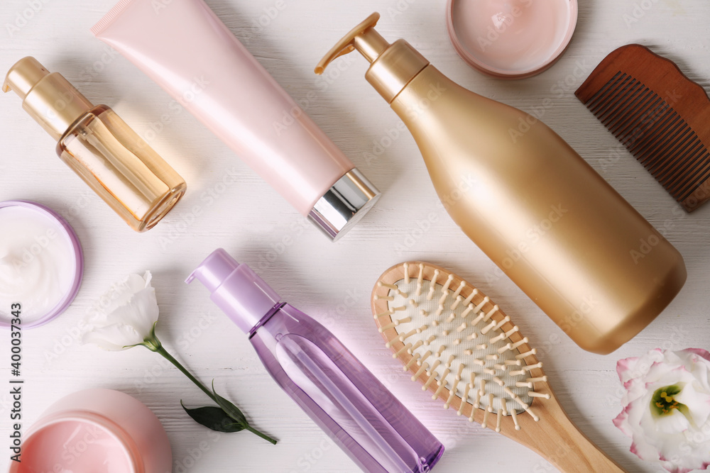 Fototapeta Flat lay composition with different hair products and accessories on white wooden table