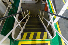 Steps And Stairs On Board Offshore Ship Marked With Yellow Black Stripes. Safety Walkways, Safety Marking On Board Vessel.