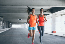 Two Female Runners Jogging Around The City .Urban Workout Concept.