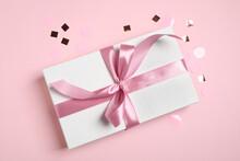 Beautiful Gift Box And Confetti On Pink Background, Flat Lay
