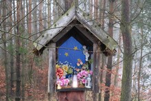 Little Wayside Shrine Hanging On Tree By Forest On Foggy Autumn Day