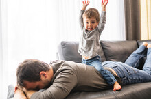 Tired Young Father With Boy On Back A Concept Of Hyperactive Children And Tired Parents